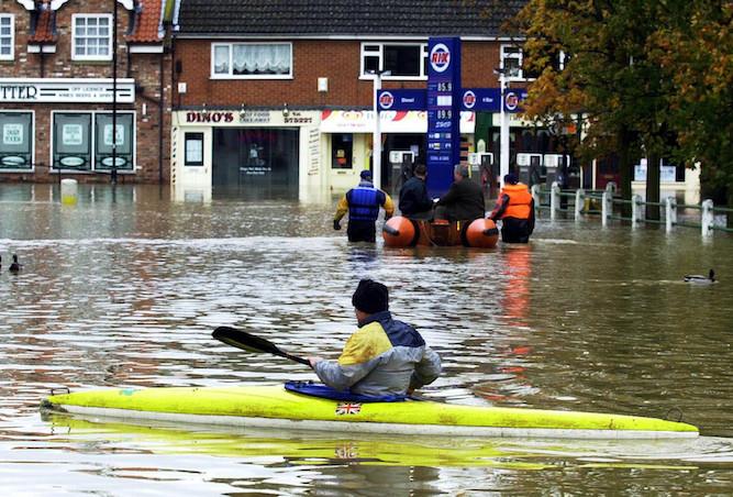 canoeflood-1 Some dick going down high street in canoe