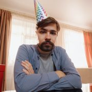 Sad man with party hat